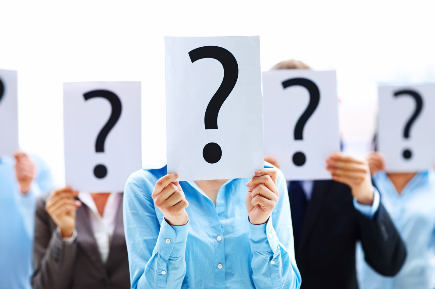 Business people with question mark on boards
